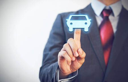 gift accident: Businessman pressing car icon in the air with one finger. Stock Photo