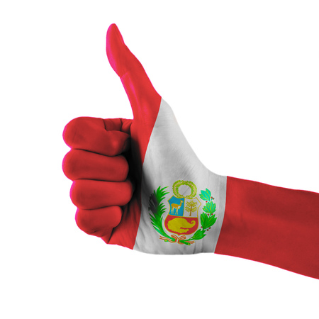 Peru flag painted hand showing thumbs up sign on isolated white background