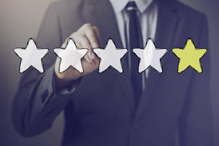 rating: Businessman drawing one star in the air - indicates disatisfaction, unhappy, bad performance in service and product