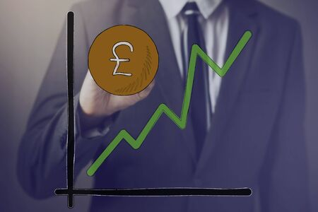 widely: Businessman drawing increasing diagram of Pound Sterling Currency - Pound Sterling is widely used in United Kingdom