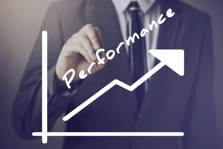 performances: Businessman writing increasing positive Performance chart upward - indicates better performance measure such as company, sales, employee, management, income, etc.