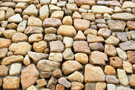 Medieval style stonewall texture for background Stock Photo