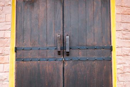 doorway: Close-up of medieval wood entrance doorway with ancient brick arc doorway.