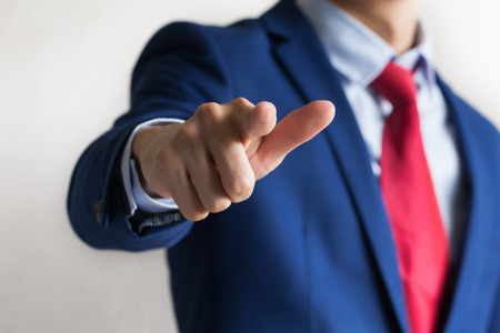 Confident business manager pointing at camera as We Want You gesture - indicates company looking for new employees Banque d'images