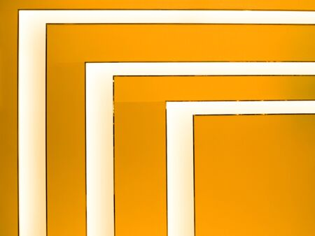 angles: Photo of light angles in bright orange background.