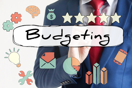budgeting: Budgeting drawn on virtual board by businessman - indicates budgeting, financial planning, investment, analysis