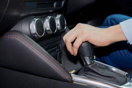 shifting: Human hand shifting automobile gear inside the car. Stock Photo