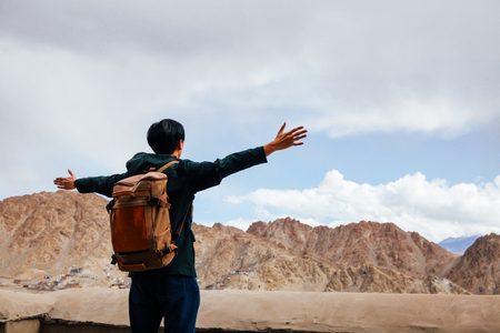 spreading arms: Happy young traveler spreading arms in city background in Leh, Ladakh, India Stock Photo