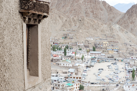 leh: Tibetan styled window with Leh Ladakh cityscape in background. Stock Photo