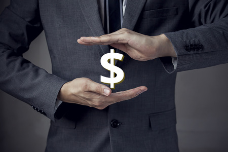 3D US Dollar sign in between two hands of businessman.