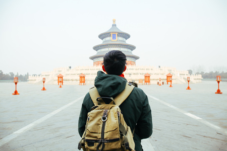 Young traveler walking towards temple of heaven - in Beijing, China. Asia Travel Stock Photo - 69471475