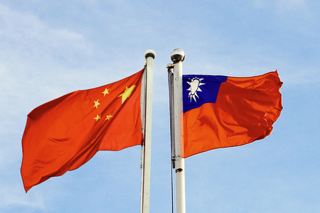 Mainland China and Taiwan flag waving over blue sky