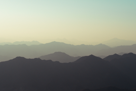 Landscape of nature mountain terrain hills layered in silhouette shade - with copy space