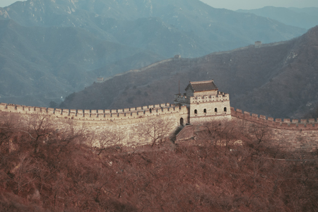 The Great Wall of China over nature mountain hills in Beijing, China - with copyspace