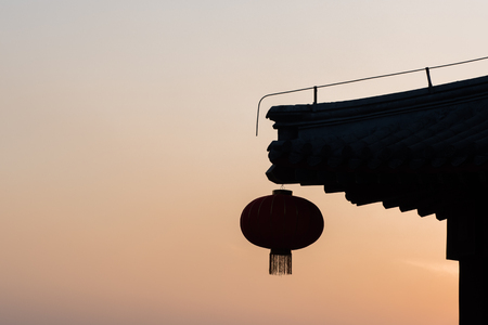 Silhouette of Chinese lanterns during sunset - with copyspace