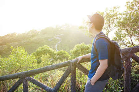 Man hiking and looking out in the mountain - travel and hiking concept Stock Photo