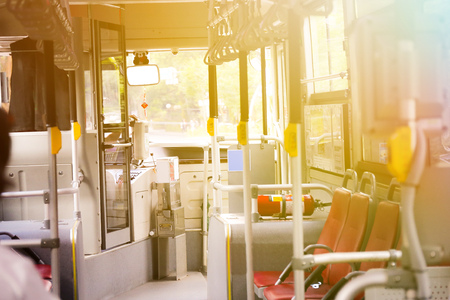 Bus empty seats interior with nobody inside - transportation concept