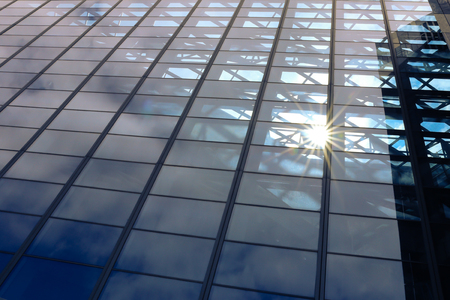 Sun light through blue glass corporate business building architecture background - with copyspace Stock Photo