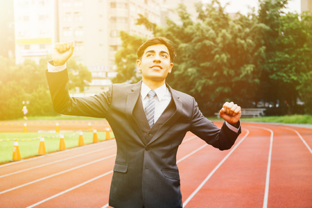 Happy and excited executive business man raising his hands up and smiling Stok Fotoğraf
