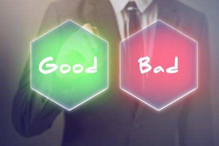 Businessman having to choose between good or bad decision