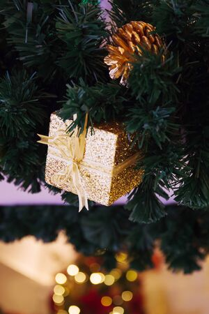 Beautiful decorated Christmas tree background with pine cone and xmas ornaments blurred in bokeh home Stock Photo