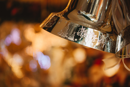 Christmas bell hanging with night lights blurred in background Stock Photo
