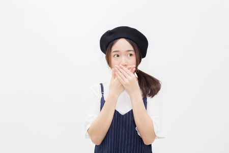 Asian female person covering her mouth in white isolated background Foto de archivo