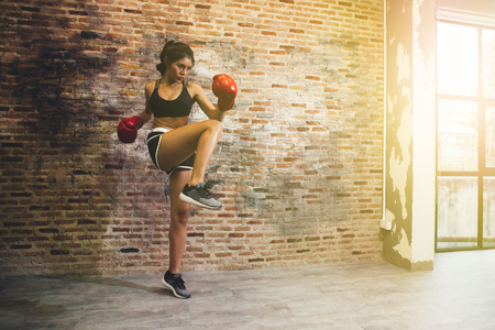 Young female boxer training fitness boxing at gym, exercise fitness for healthy and slim body