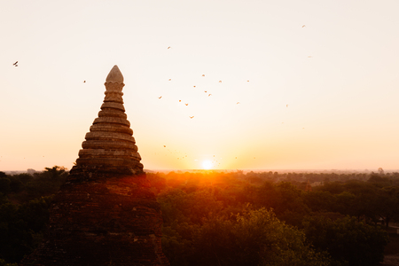 Buddhist temple shape against sun light during sunrise Stock Photo - 93804971