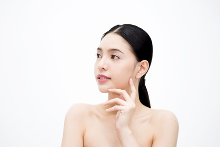 Young beauty Asian face, beautiful woman isolated over white background. Healthcare and Skincare concept Stock Photo