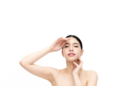 Young beauty Asian face, attractive woman isolated over white background. Healthcare and Skincare concept Stock Photo