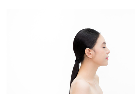 Happy young beautiful and elegant Asian woman in side view isolated over white background, Healthcare and Skincare concept