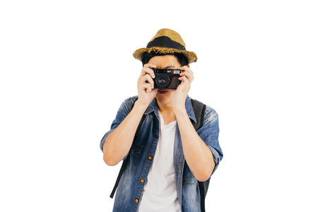Young tourist with hat and sunglasses smiling and holding camera isolated over white background with clipping mask Stock Photo