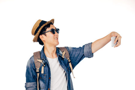 Young Asian tourist smiling and taking a selfie isolated over white background Stock Photo