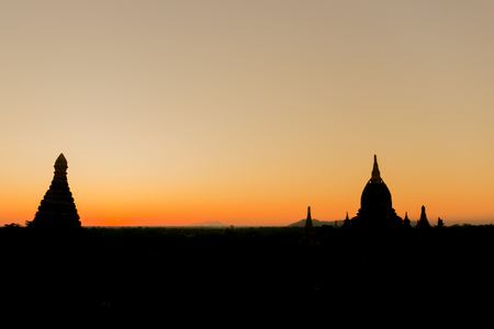 Sillhouette of Buddhist temple shape against sun light during sunrise Stock Photo - 96962210