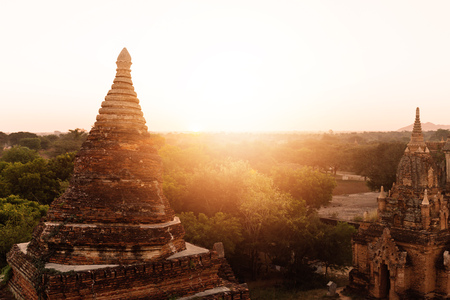 Buddhist temple shape against sun light during sunrise