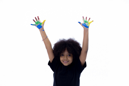 African American playful and creative kid getting hands dirty with many colors - in white isolated background Archivio Fotografico - 105389066