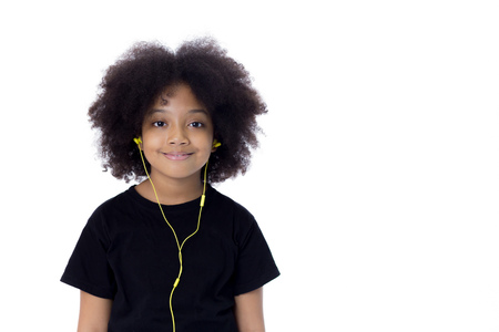 African American afro kid listening the music  with earphones - in white isolated background Stock Photo