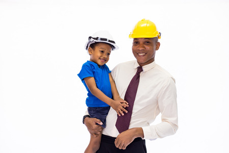 African American happy family of father and son wearing an engineering helmet together, like father like son or well education conccept Stock Photo