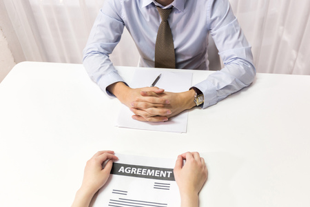 Businessman talking, making a deal, interviewing, negotiating with other businessman or applicant. Various kinds of business situations can be applied.