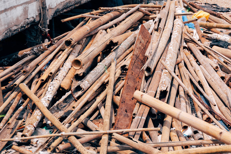 Many heap waste woods piled up in industrial construction site