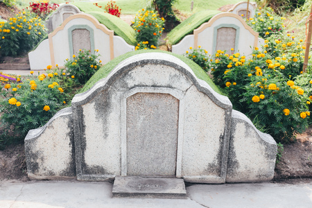 Chinese cemetery on Tomb Sweeping Day. Asian graveyard on the mountain valley scene