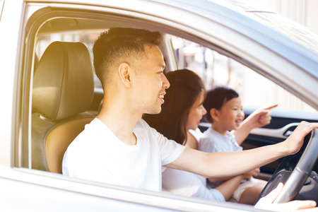Happy Asian family is smiling and travelling on the road trip, going for a drive for vacation Stockfoto