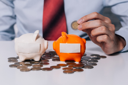 Young man collecting money coins and allocate coins into categories - risk management and investment concept Stock Photo