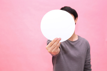 Young man showing and presenting an empty blank rounded mockup paper - with copy space to insert any text Stock Photo