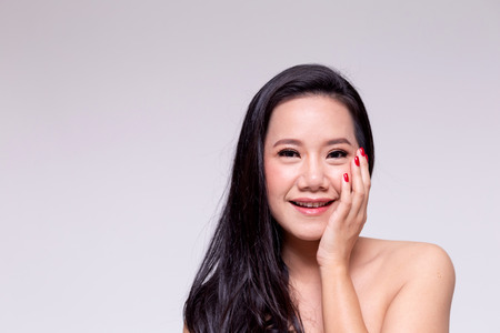 Face of beautiful Asian woman in white isolated background - beauty and skin care concept 스톡 콘텐츠