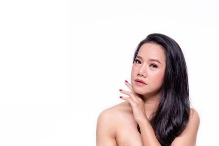 Face of beautiful Asian woman in white isolated background - beauty and skin care concept Stock Photo