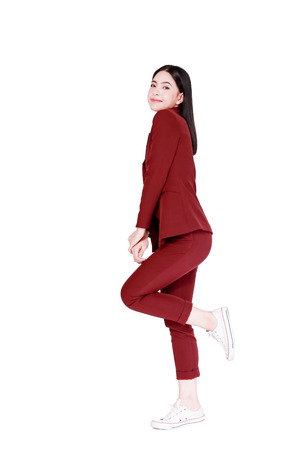 Young fashionable beautiful Asian woman in elegant red suit in white isolated background 写真素材