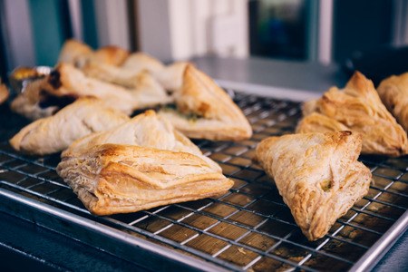 Close-up of many handmade breads on tray freshly baked from over in kitchen for commercial bakery shop Stock Photo