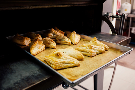 Freshly baked and delicious breads produced from metal oven in kitchen of bakery house shop Reklamní fotografie